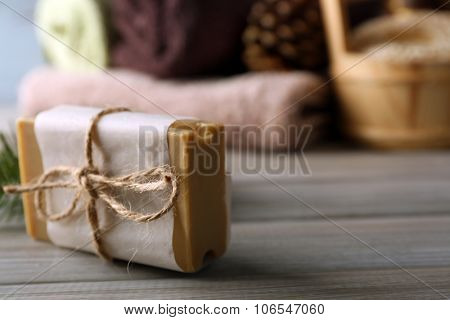 Handmade soap with pine extract and spa treatments on wooden background
