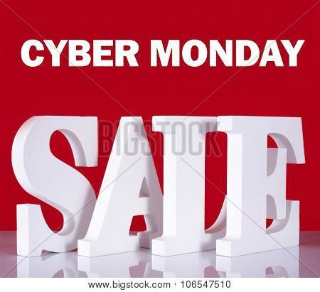 Cyber Monday Wooden Sale Letters On Red Background.