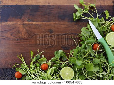 Salad Preparation With Watercess On Wooden Table.