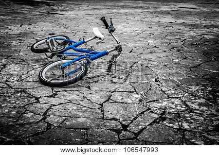 Artistic Dark Vintage Edit Of A Left Children's Bicycle On A Cracked Concrete Floor, Concept Of Inte