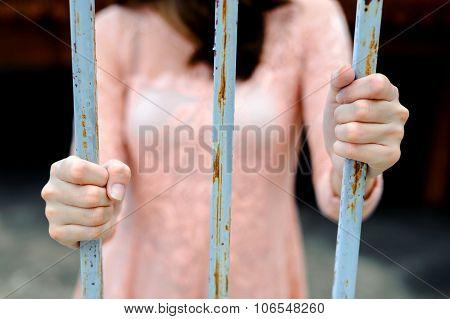 Woman Hand On Iron Bar
