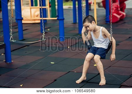 Sad Boy At Playground