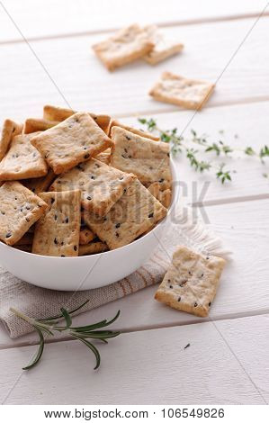 crackers with herbs and black sesame seeds on table