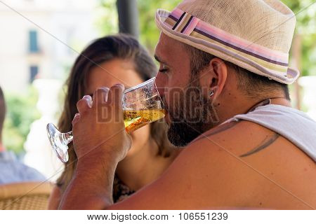 Man Drinking Beer In A Cafe
