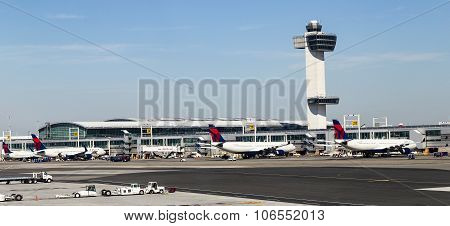 Air Traffic Control Tower And Terminal 4 With Air Planes At The Gates In Jfk Airport