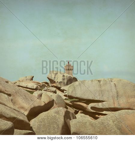 Lighthouse on the Pink Granite Coast in Brittany in grunge and retro style.