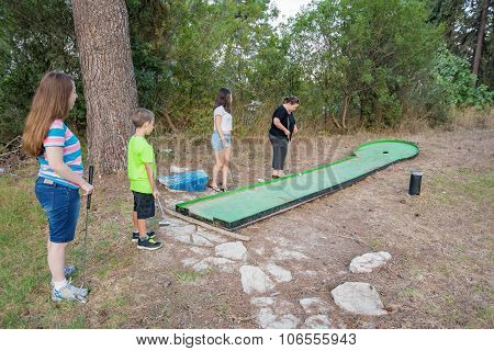 Family Playing Miniature Golf In The North Of Israel