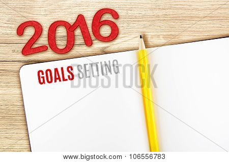 2016 Goals Setting Word On Notebook Lay On Wood Table,template Mock Up For Adding Your Goal