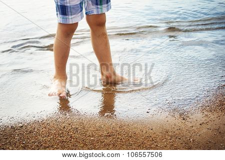 Boy's feet in the sea