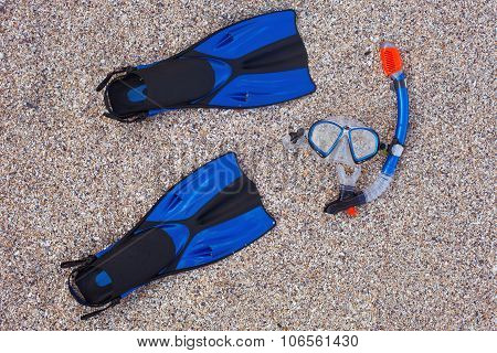 Snorkeling Set. Mask And Flippers On A Sand Beach