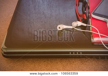 Earbuds And Laptop