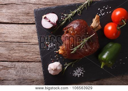 Baked Pork Shank And Vegetables On A Slate Board. Horizontal Top View