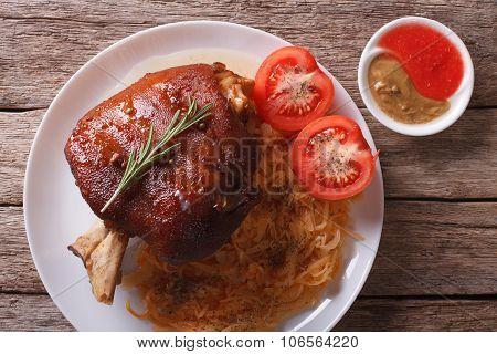 Pork Shank, Sauerkraut And Sauce Closeup. Horizontal Top View