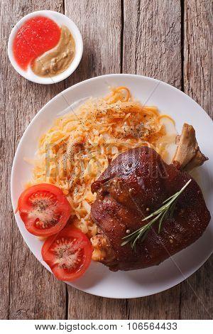 Pork Shank, Sauerkraut And Sauce Closeup. Vertical Top View