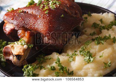 Tasty Pork Shank And Mashed Potato Closeup. Horizontal
