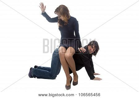 Woman sitting on man in jacket and beating him