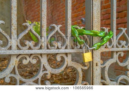 Old Ornamental Vintage Iron Metal Gate Locked With A Chain And A Lock