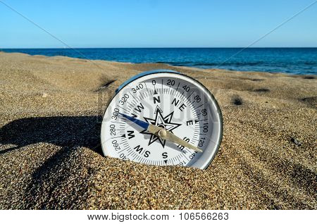 Compass on the Sand Beach