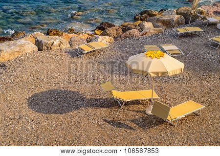 Two Sun Beds At Sunset On An Empty Beach