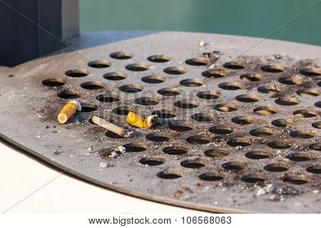 Smoked Cigarettes In A Dirty Outdoors Ash-tray