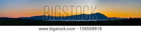 Panoramic Mountain Landscape With Lake At Sunset