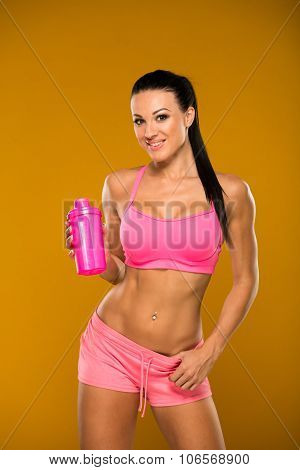 beautiful fitness model on a yellow background