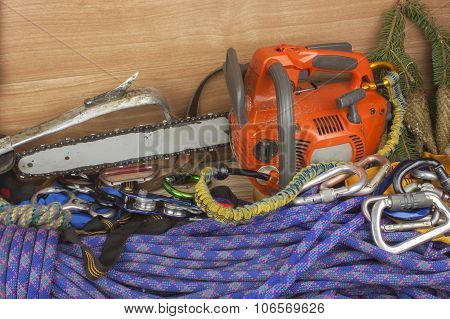 Tools for trimming trees, utility arborists. Chainsaw to work lumberjack. Arbor