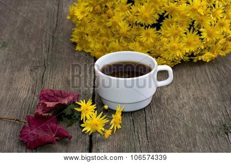 Bouquet Of Yellow Flowers, Coffee, Red Leaf And Floret, On A Wooden Table, Fall A Still Life