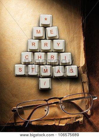 Christmas card - Christmas tree made of computer keys and glasses, Old paper background