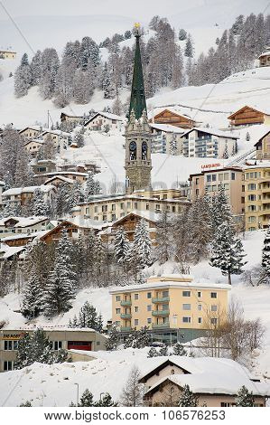 View to the buildings and church bell tower in St. Moritz, Switzerland.