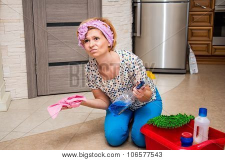 Tired Housewife Is Cleaning The Floor