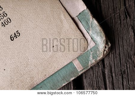 Open Book With Frayed Cover On Wooden Texture