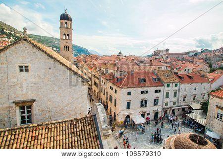 Tourists walking on Stradun and around Onofrio fountain in Dubrovnik, Craotia