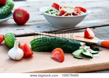 Chopped Cucumber And Tomato Salad On A Cutting Board