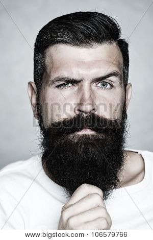 Grey-haired Man Pulling Beard