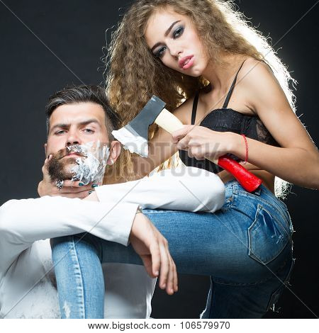 Woman Shaving Man