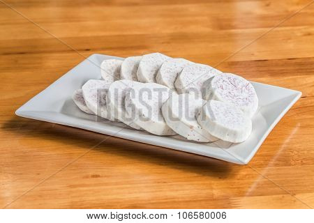 Taro slice on dish over the wooden table