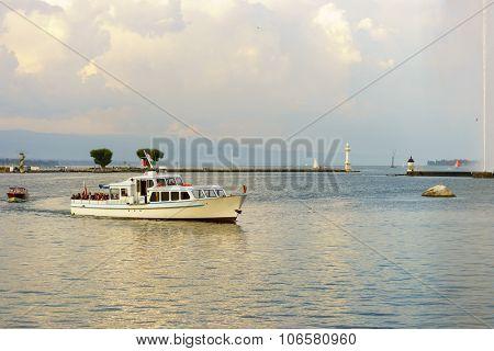 GENEVA, SWITZERLAND - SEPTEMBER 14, 2014: boat cruise on Lake Geneva. Lake Geneva iis a lake on the north side of the Alps, shared between Switzerland and France.