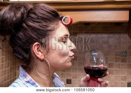 Woman In Curlers  In The Kitchen