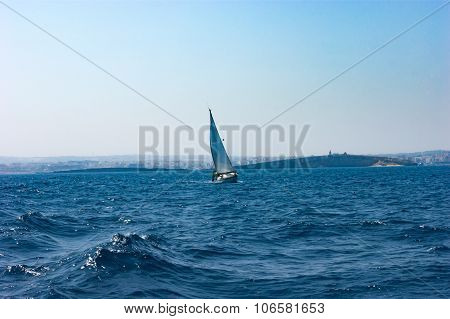 Yacht in blue, vibrant mediterranean sea