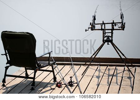 Fishing Rods On Wooden Pier