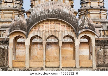 Columns And Textured Wall Of Vintage Towers In Hindu Temple