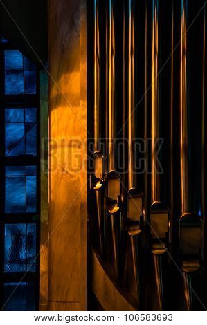 Dark Artistic Edit Of A Detail Of An Organ With Blue Stained Glass
