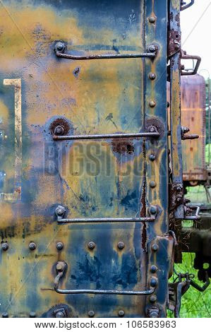Rusty Ladder On Blue Train Car