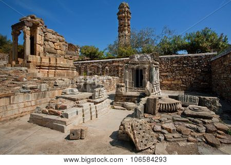 Ruins Of Hindu Temples And Tall Building Of 15Th-century Vijay Stambha - Tower Of Victory.