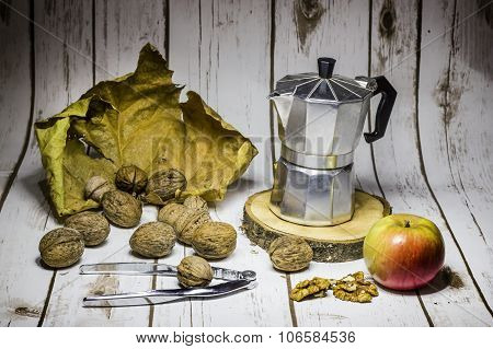 Walnuts With Cracker And Coffee Maker