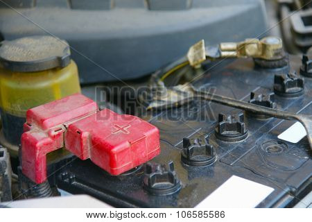 Dirty Car Battery With Red Positive Polarity For Auto Concept (selective Focus At Positive Symbol)