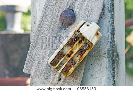 Old Retro And Broken Dirty Rust Electric Circuit Breaker Mounting On Wooden Outdoor Panel