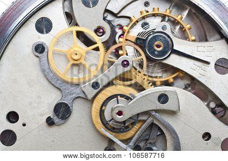 Metal Cogwheels Inside Clockwork. Conceptual Macro Photo.
