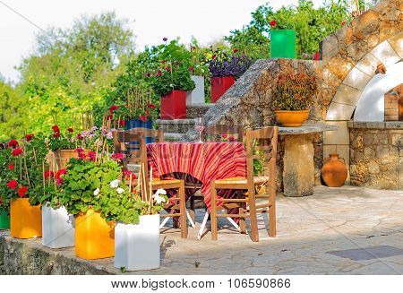 Mediterranean cafe terrace exterior with chairs and table